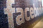Signage made up of individual faces is displayed inside the Facebook Inc.