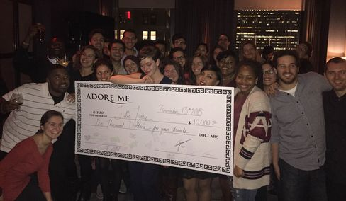 Julie Tracy with the check from Adore Me.