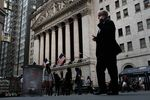 A man walks by the New York Stock Exchange.