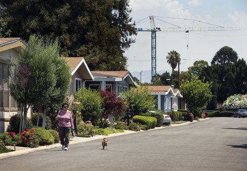 Alba Salciccia, walks her dog, at the Winchester Ranch mobile home park in San Jose, Calif., on July 31, 2015.