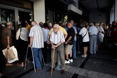 Pensioners queue to enter a National Bank of Greece branch to collect their pensions in Thessaloniki on Thursday, July 9, 2015.