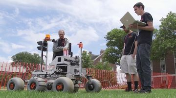 A team readies its robot for the the NASA Centennial Challenge.