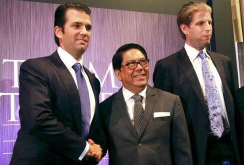 Jose E. B. Antonio, center, with Donald Trump Jr., left, and Eric Trump