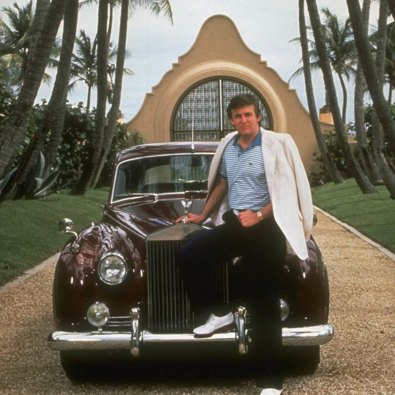 Real estate tycoon Donald Trump posing next to Rolls Royce in driveway of home (prob.) Mar-a-Largo.  (Photo by Ted Thai/The LIFE Picture Collection/Getty Images)