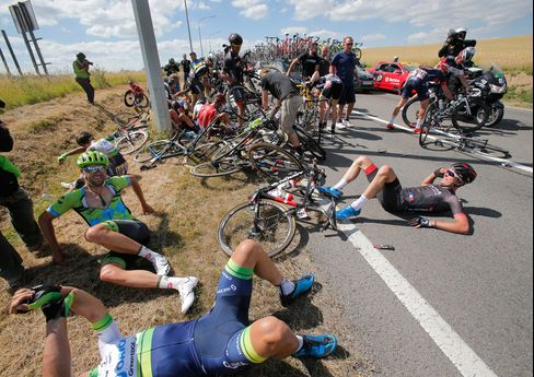 Scores of riders on the road after crashing during the third stage of the Tour de France Belgium on July 6, 2015.