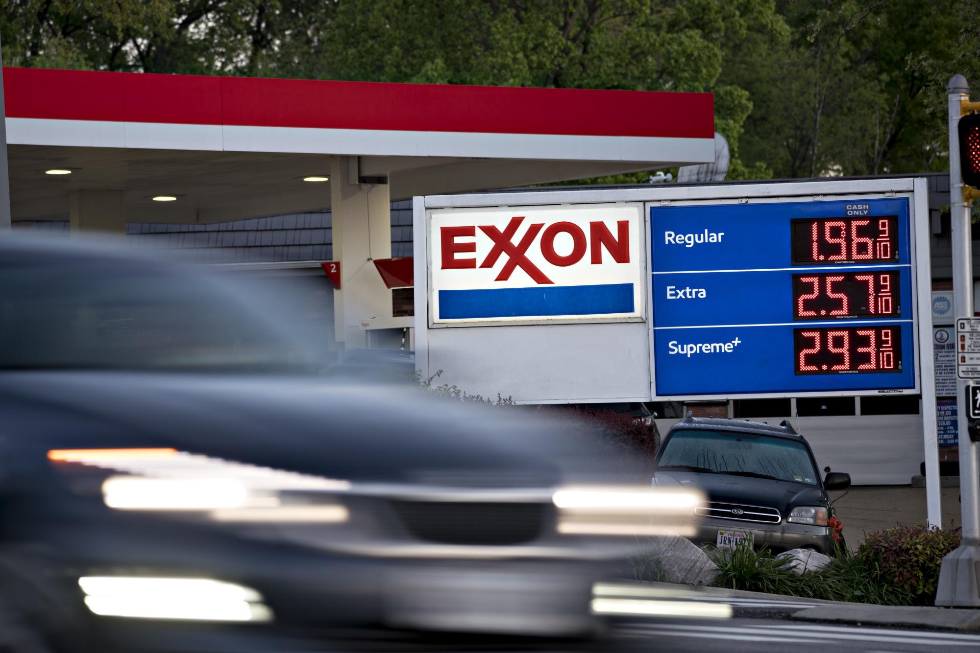 A vehicle passes an Exxon Mobil Corp. gas station in Arlington, Virginia.