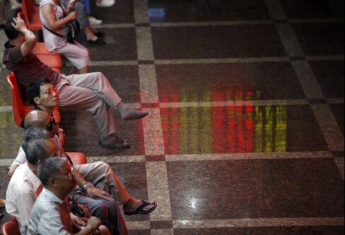 China's Stocks Rise as Greek Poll Overshadows Home Price Slump