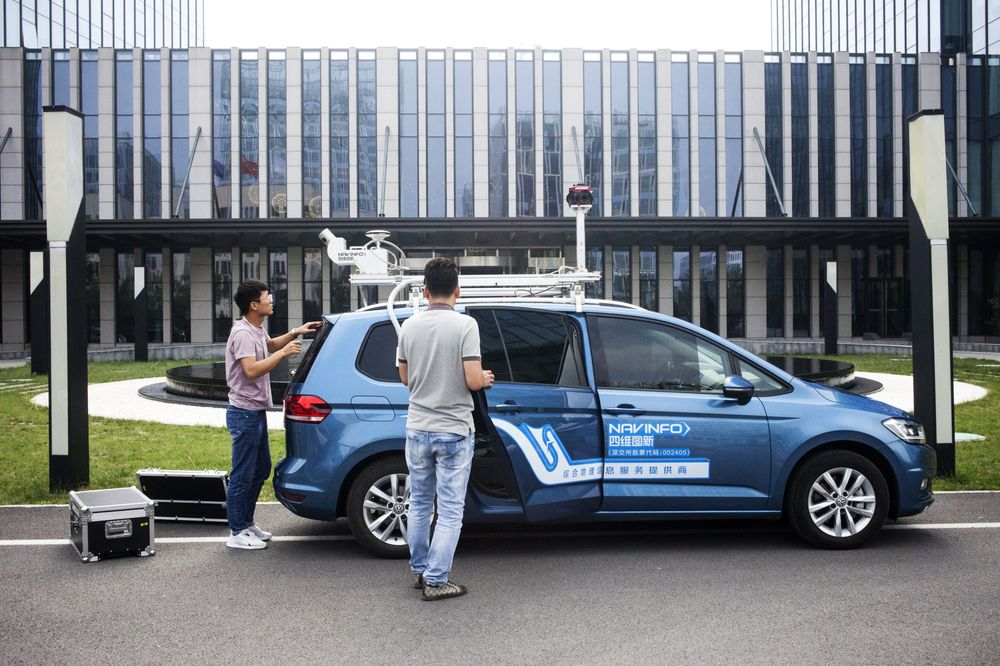 377259413add Employees prepare a NavInfo vehicle for data collection in Beijing on June  11.