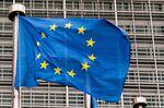 A European Union flag flies outside the Berlaymont building in Brussels, Belgium.