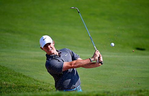 Rory McIlroy, coming back from an ankle injury, plays a bunker shot during a practice round prior to the 2015 PGA Championship at Whistling Straits in Sheboygan, Wisconsin, on Aug. 12, 2015.