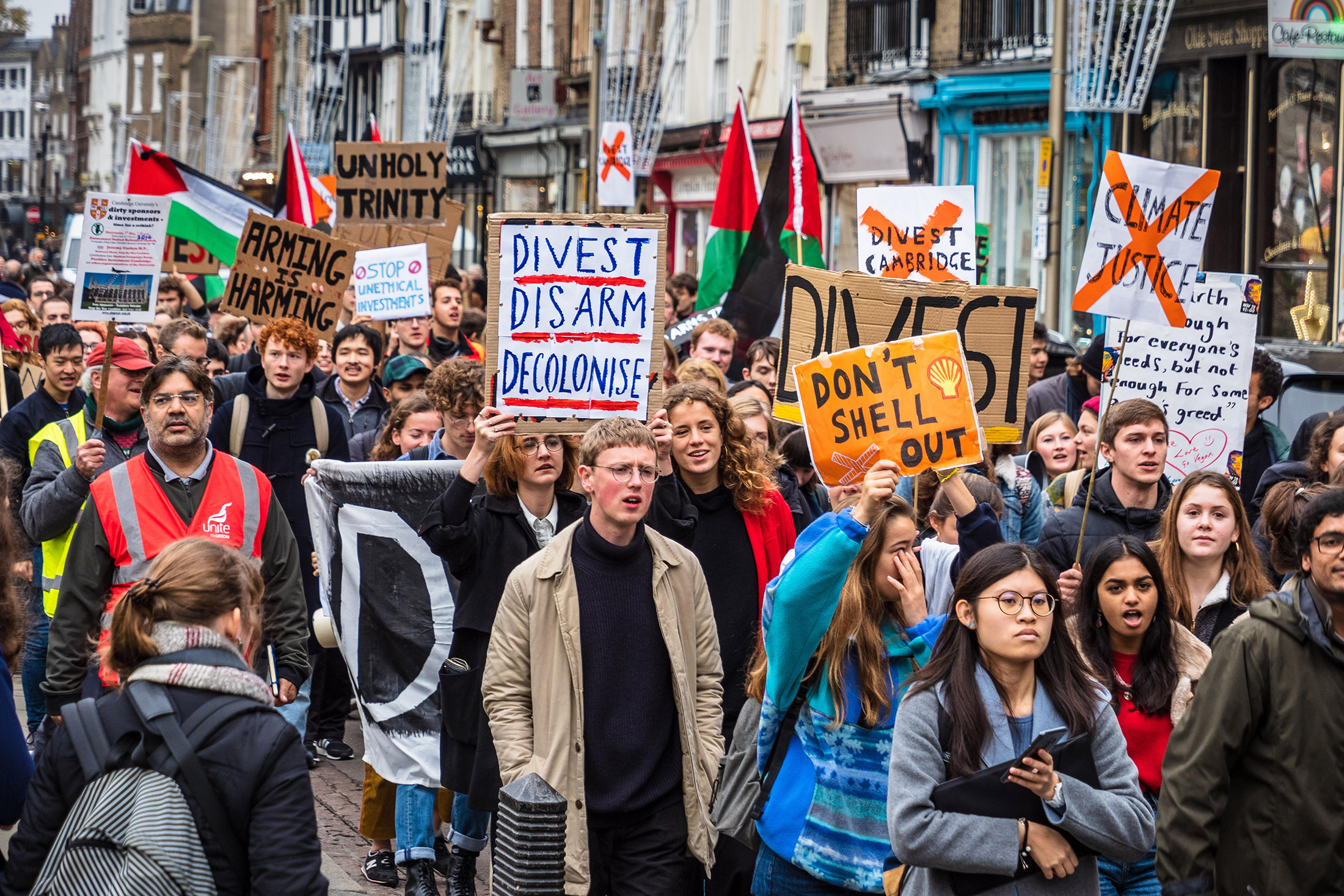 Cambridge University students march through central Cambridge demanding the university divest its unethical investments in arms and fossil fuels companiesin 2018.