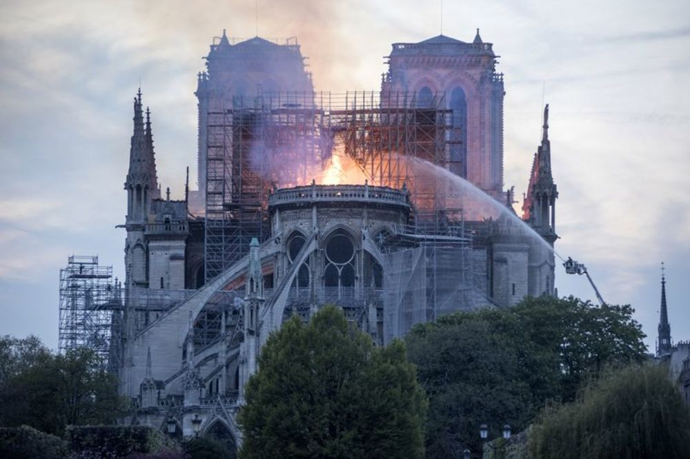 Flames and smoke rise from a fire at Notre,Dame Cathedral in Paris, France