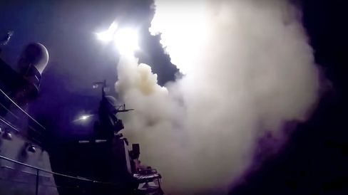 In this photo made from the footage taken from Russian Defense Ministry official web site, on Oct. 7, 2015, a Russian navy ship launches a cruise missile in the Caspian Sea.