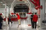 Tesla Motor Inc. associates work on the Model S electric car at the company's factory in Fremont, California, U.S.