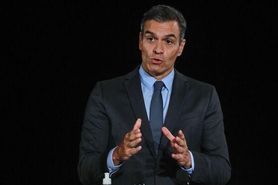 Spanish Premier Picks the Risky Option Backing Catalan Bank Deal