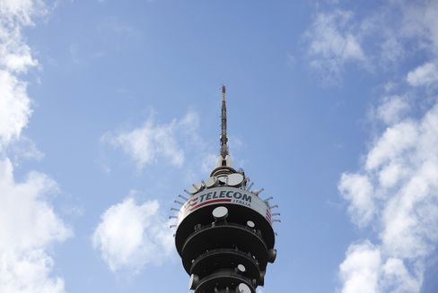 The Telecom Italia Logo Sits on a Communications Tower in Rome