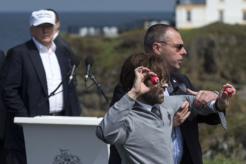 A protester attempted to present Donald Trump with a set of red swastika-branded golf balls in Turnberry, Scotland on June 24, 2016.