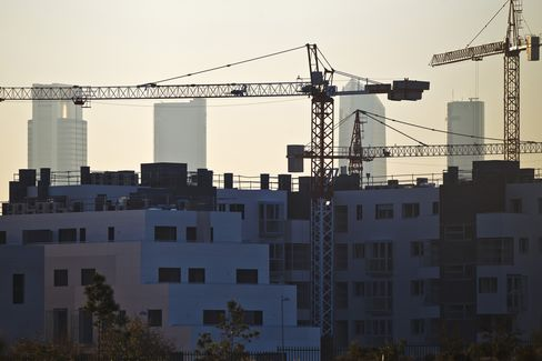 Construction Cranes Operate Above Apartment Blocks in Madrid