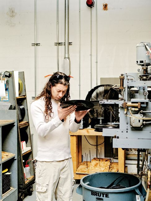 5. QRP inspects each record as it comes off of the press for visible imperfections. One out of every 50 records gets a test listen.