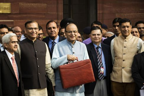Arun Jaitley, India's finance minister, Jayant Sinha, State finance minister, second right, and other members of the finance ministry in New Delhi, India, on Feb. 29.