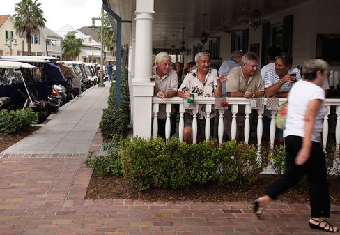 Residents watch passers by from a restaurant in The Villages, billed as Florida's Friendliest Retirement Hometown.