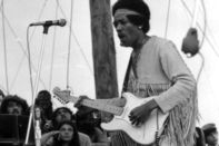 Jimi Hendrix performing at the Woodstock Music Festival