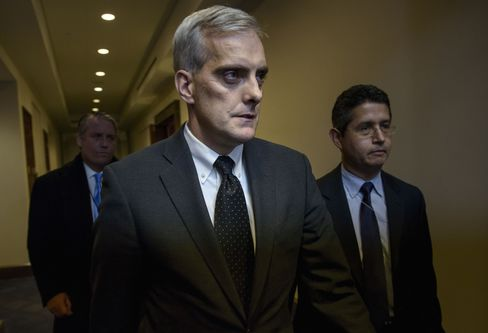 White House Chief of Staff Denis McDonough leaves a meeting of House Democrats on Capitol Hill .