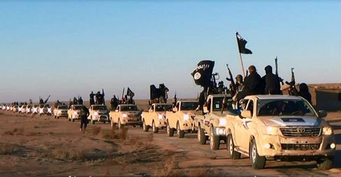 A convoy of Islamic State fighters and vehicles in Iraq's Anbar Province in January 2014.