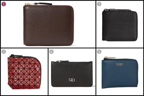 (1) Zip-around leather wallet, Comme des Garçons, $180, mrporter.com; (2) Small python ziparound coin wallet, Burberry, $595, burberry.com; (3) Bao Bao zipper wallet, Issey Miyake, $250, ssense.com; (4) Credit-card case, Salvatore Ferragamo, $240, ferragamo.com; (5) Corner Zip, Vianel, $290, vianelnewyork.com