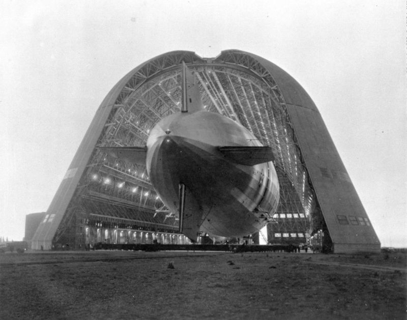 Dirigible USS Macon entering Hangar One at the NASA Ames Research center in Mountain View, California, 1934. Image courtesy NASA. (Photo via Smith Collection/Gado/Getty Images).