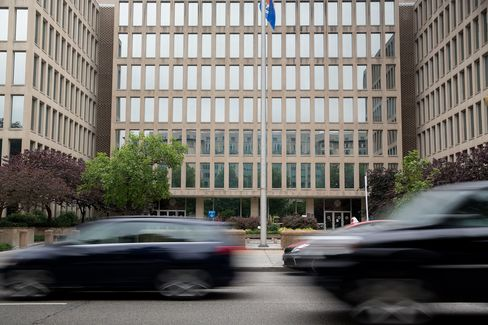 Vehicles drive past the Theodore Roosevelt Building, headquarters of the U.S. Office of Personnel Management (OPM), in Washington, D.C.