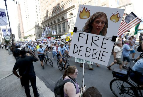 A demonstrator holds up a sign calling for Wasserman Schultz to be fired, in Philadelphia, on July 24.