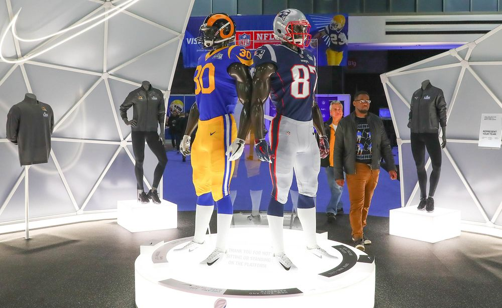 Los Angeles Rams and New England Patriots uniforms on display at the NFL at  the Super 10bb2f77e