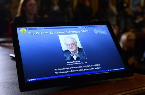 A photograph of Professor Angus Deaton is displayed at a press conference to announce the 2015 Nobel Economics Prize.