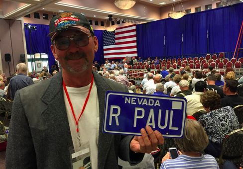 Pahrump, Nevada Republican Rich Bushart displays the license plate he got for his own car.