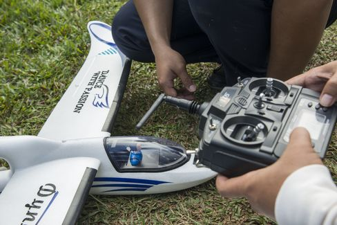 A drone being checked and callibrated pre-flight in Sembawa, Indonesia. Photographer: Rony Zakaria/Bloomberg