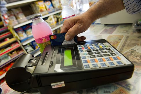 Swipe-Fee Battle Moves to States as U.S. Banks Fight Surcharges