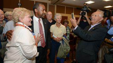 Republican presidential candidate ben carson has his picture taken on sept. 30, 2015, in exeter, new hampshire.