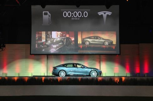 Gone in 90 Seconds: Tesla's Battery-Swapping Magic