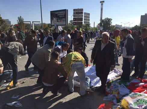 People gather at the site of an explosion close to Ankara's main train station on October 10, 2015 in Ankara, Turkey.