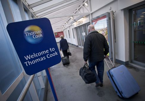 Thomas Cook Check-In Desks As Shares Slide 75 Percent