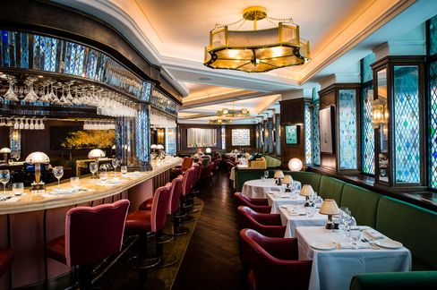 The bar in the center of the room at The Ivy is one of the best places to sit.