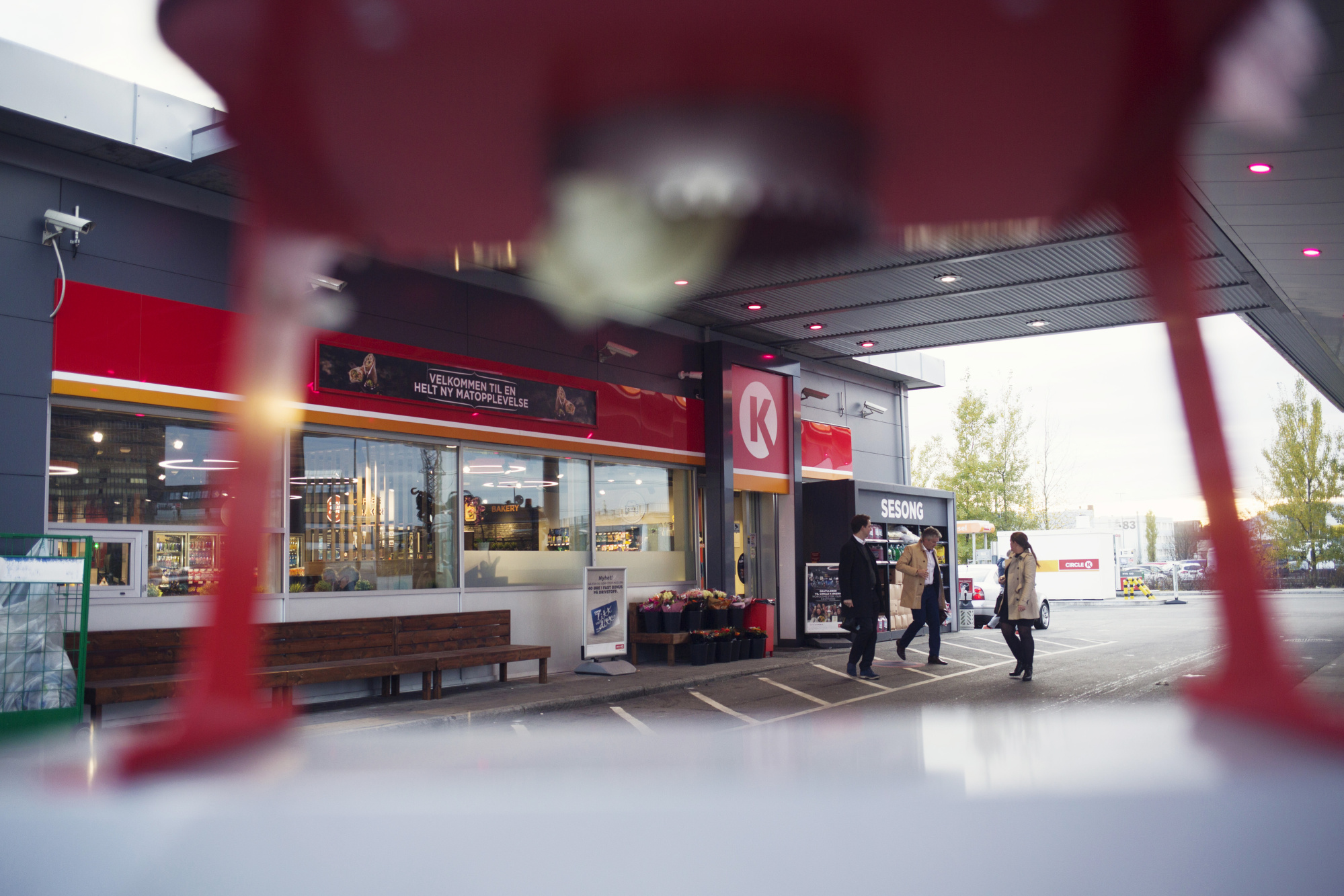 Customers exit the store at a Circle K gas station, operated by Alimentation Couche-Tard Inc., in the Oekern district of Oslo, Norway, on Tuesday, Oct. 31, 2017. Couche-Tard is using the Nordic country as a testing ground for how to respond to the electric-vehicle boom.
