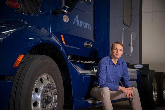 Aurora's Plan to Catch Waymo in Robot Trucks, Then Taxis