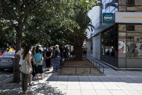 Greeks drain banks as Greece imposes capital controls