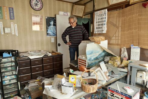 Haruhisa Endo looks inside his home in the town of Tomioka, Fukushima, Japan.