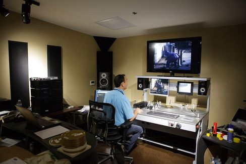 An employee works in an editing bay at the Iron Mountain archival facility in Hollywood.
