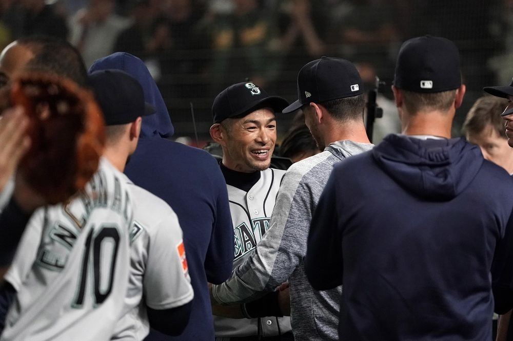 Ichiro Suzuki  51 of the Seattle Mariners is embraced by his team mates and  staffs 271aad74c