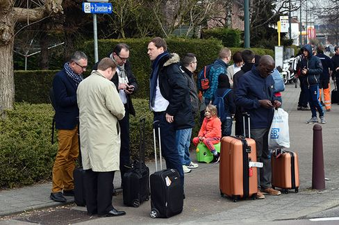 Passengers near Brussels airport following evacuation on March 22.