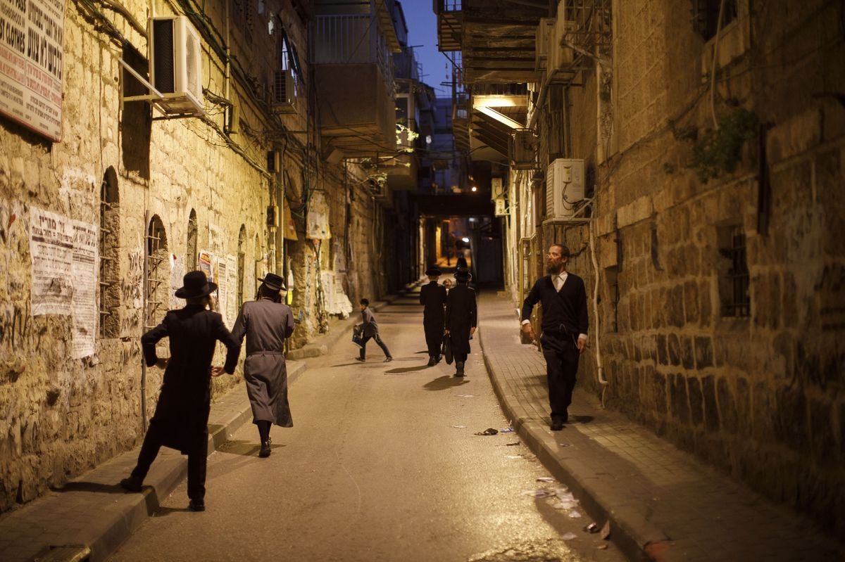 People walk through the Jewish Orthodox neighborhood of Mea She'arim in Jerusalem, Israel March 29.